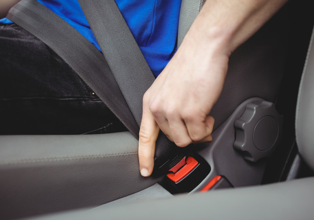 5a66990db715b6b31dab2fd0b3827dab7ecd7d3e bigstock man buckling his seatbelt in a 178259587